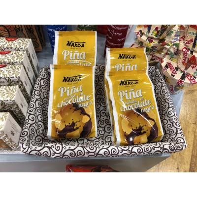Piña bañada en chocolate negro